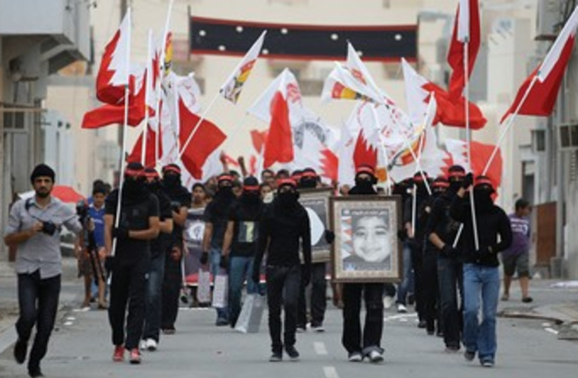 Anti-government demonstrators in Bahrain 370 (photo credit: REUTERS)