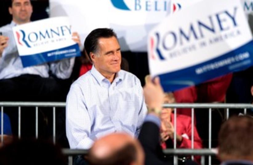 Republican Mitt Romney addresses supporters 370 (R) (photo credit: REUTERS/Darren Hauck)
