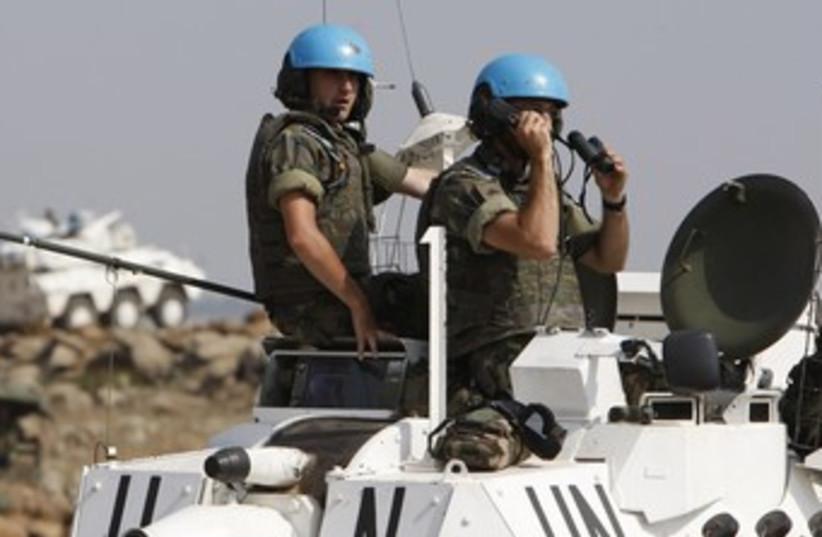 UN peacekeepers blue helmets (photo credit: Ali Hashisho / Reuters)