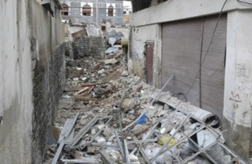 Damage rubble in the old city of Homs_370 (photo credit: Reuters)