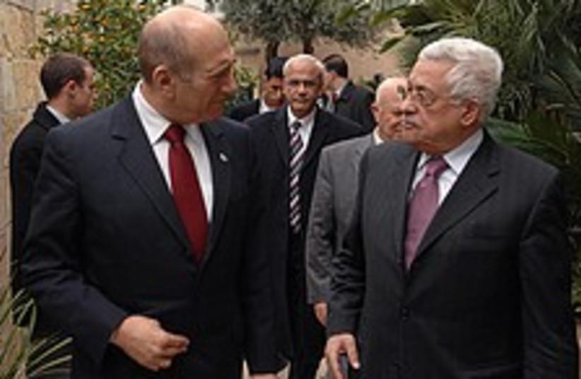 Abbas olmert walk 224.88 (photo credit: GPO)