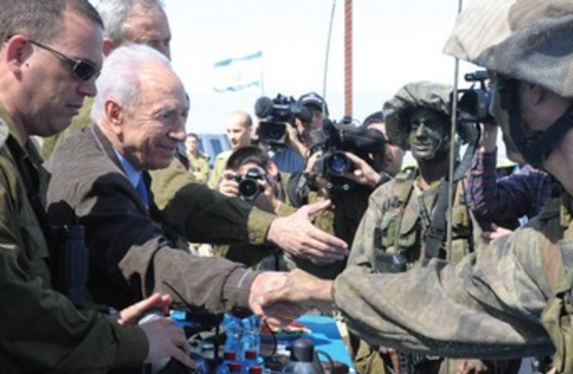 President Peres shakes hands with  7th Brigade soldiers 370 (photo credit: Mark Neiman/GPO)