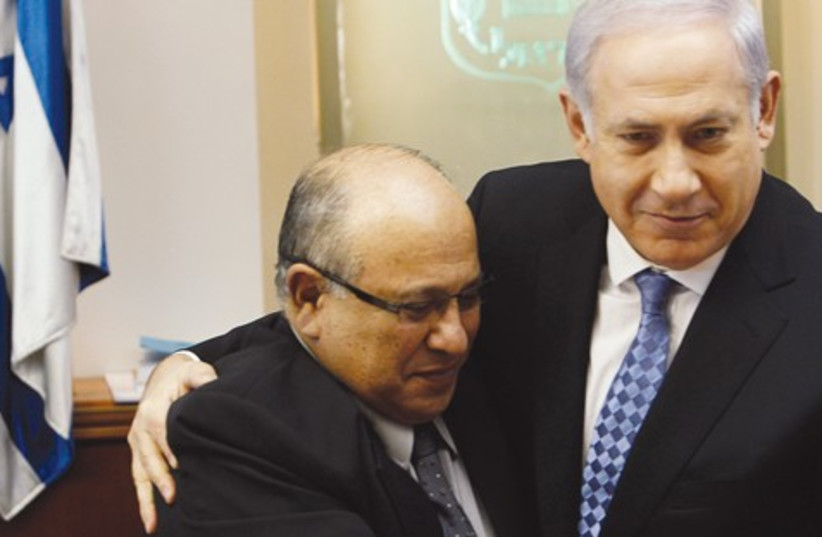 Netanyahu hugs Meir Dagan 521 (photo credit: REUTERS)