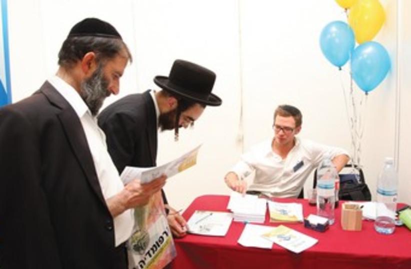 Haredi men attend a job far in J'lem 370 (photo credit: Marc Israel Sellem)