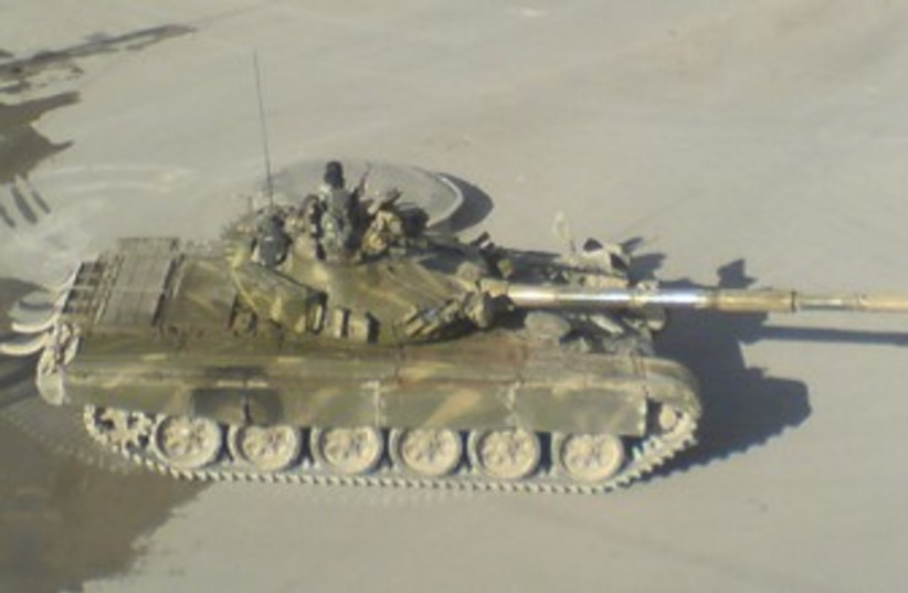 Syrian army tank is seen in Yabroud near Damascus 370 (photo credit: reuters)