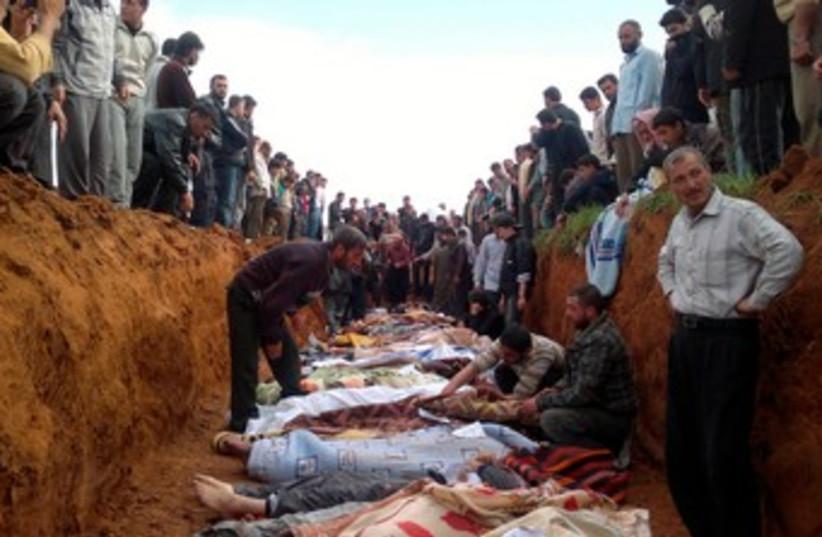 Anti-Assad Syrians bury dead 370 (photo credit: HANDOUT)