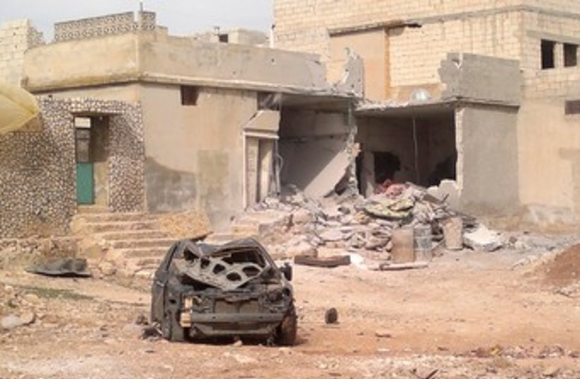 Syrian damage to car buildings 370 (photo credit: reuters)