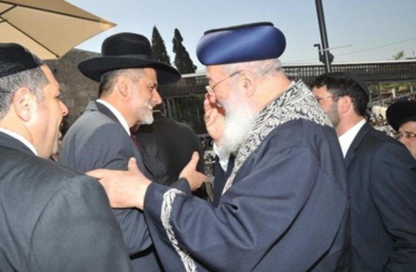Eli Yishai (L), Rabbi Shlomo Amar (R)