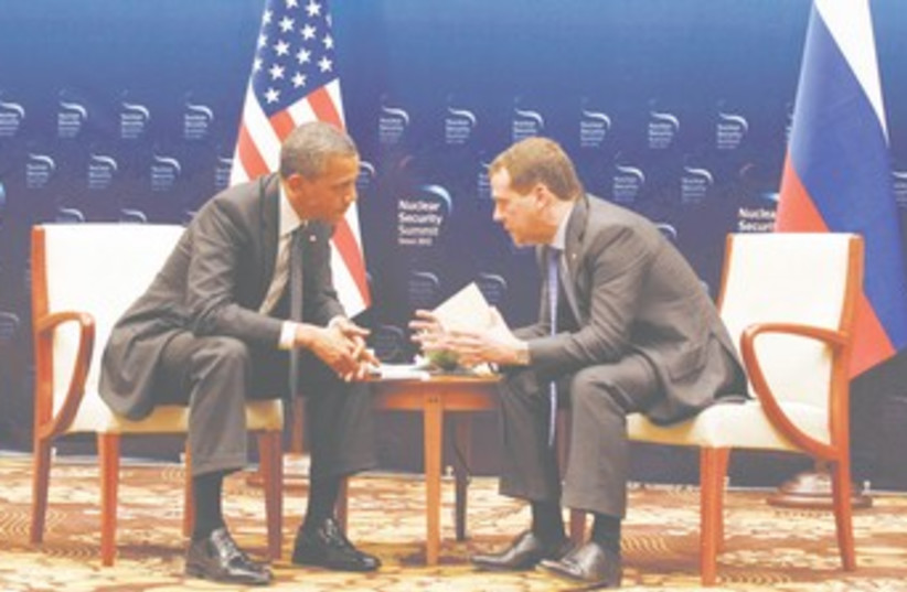 Obama, Medvedev missile defense talk 370 (photo credit: REUTERS)