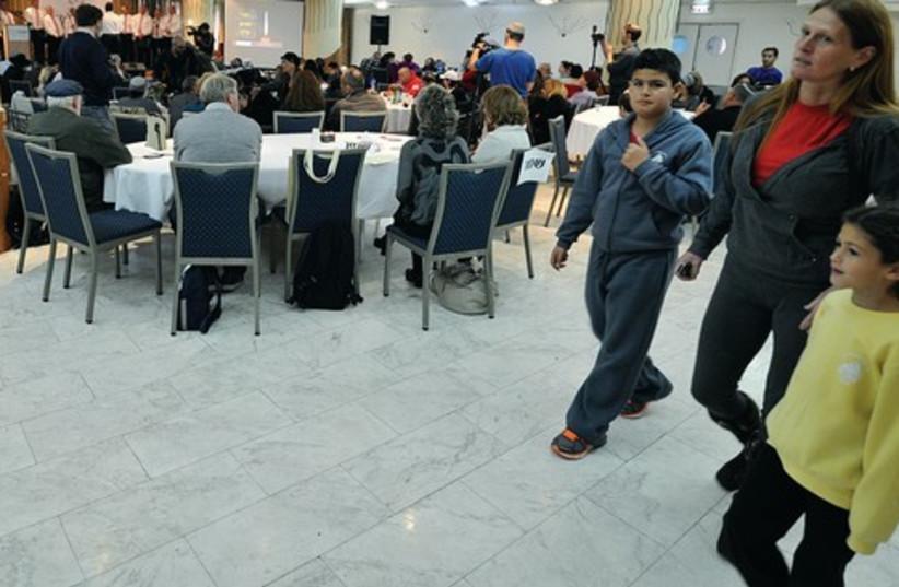 Victims, families at Park Hotel, Netanya (photo credit: Courtesy One Family)