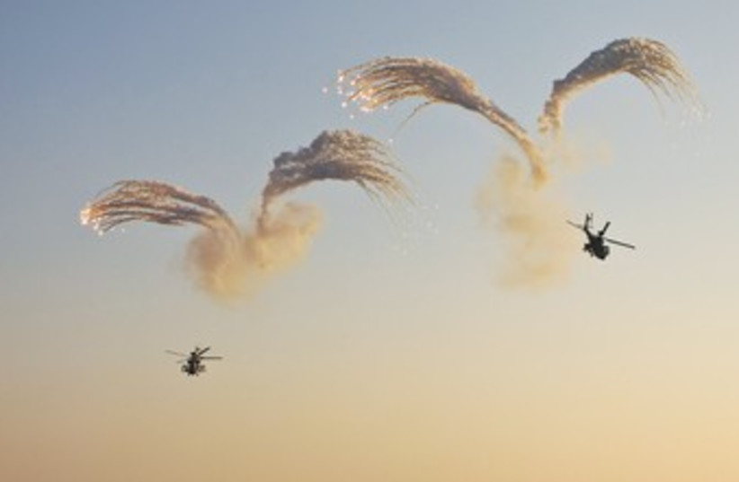 APACHE HELICOPTERS in the South 370 (photo credit: Nir Elias/Reuters)