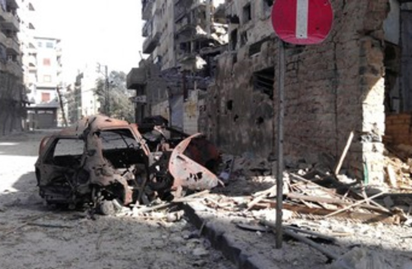 Buildings damaged by Syrian government shelling in Homs 370 (photo credit: REUTERS)