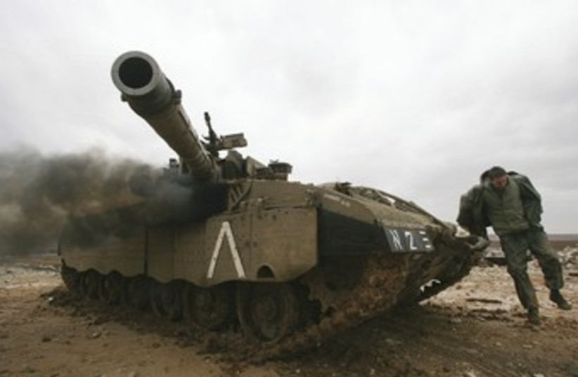 IDF soldier, tank outside northern Gaza 370 (photo credit: Reuters)