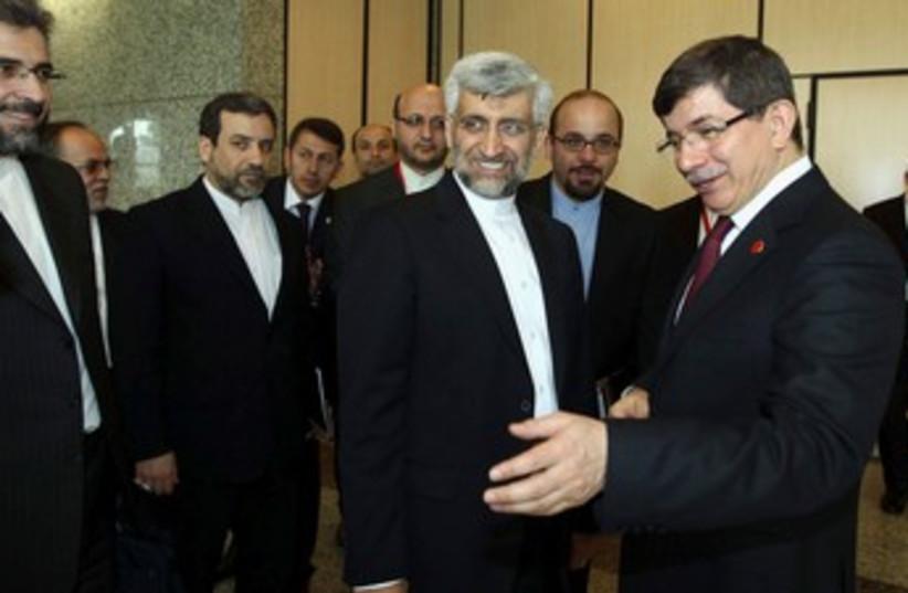 Iranian nuclear negotiator Jalili with Davutoglu 370 (photo credit: REUTERS)