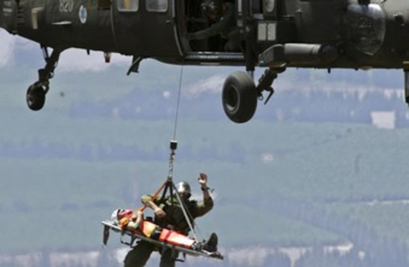 Israeli rescue helicopter 370 (R) (photo credit: Ammar Awad / Reuters)