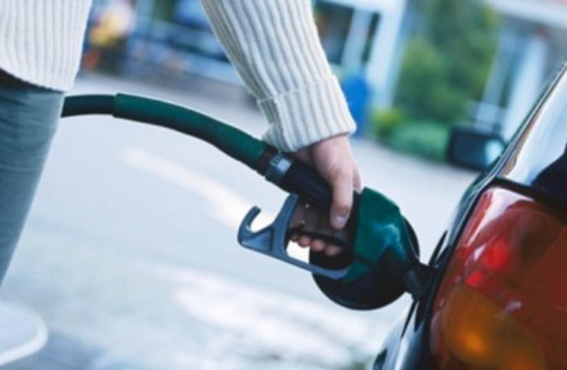 Person filling car gas tank 370  (photo credit: Thinkstock/Imagebank)