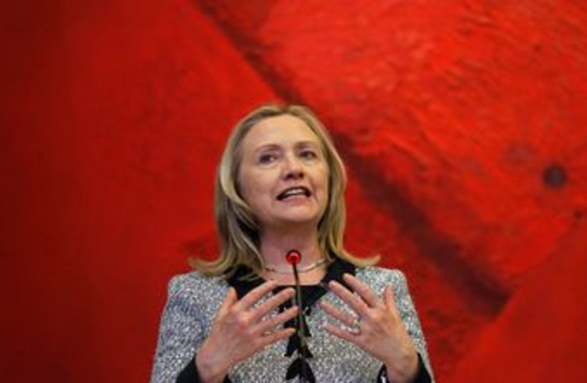 US Secretary of State Hillary Clinton in Brazil 370 (R) (photo credit: REUTERS/Ueslei Marcelino )