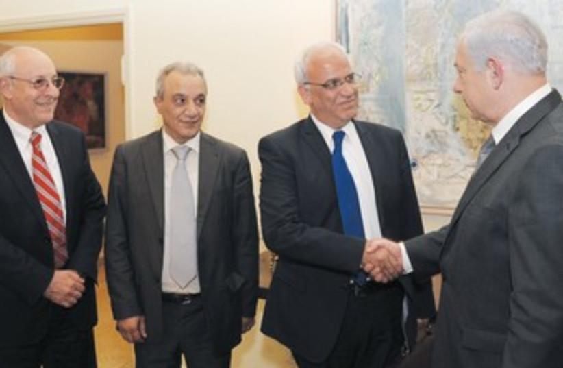 Netanyahu greets Palestinian delegation 370 (photo credit: Amos Ben-Gershom/GPO)