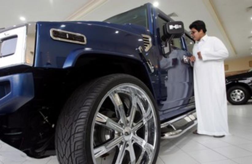 Saudi man in a car showroom 370 (R) (photo credit: Zainal Abd Halim / Reuters)
