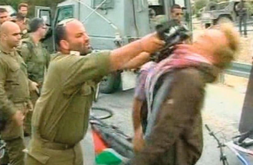 Shalom Eisner strikes protester (photo credit: Reuters)