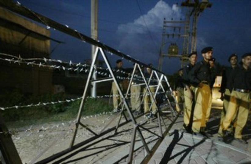 Pakistani police at Islamabad's airport 370 (R) (photo credit: Mian Kursheed / Reuters)