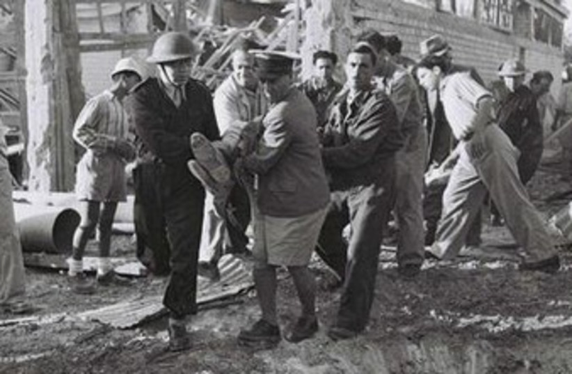 Haganah volunteers evacuate wounded 370 (photo credit: State of Israel National Photo Collection)