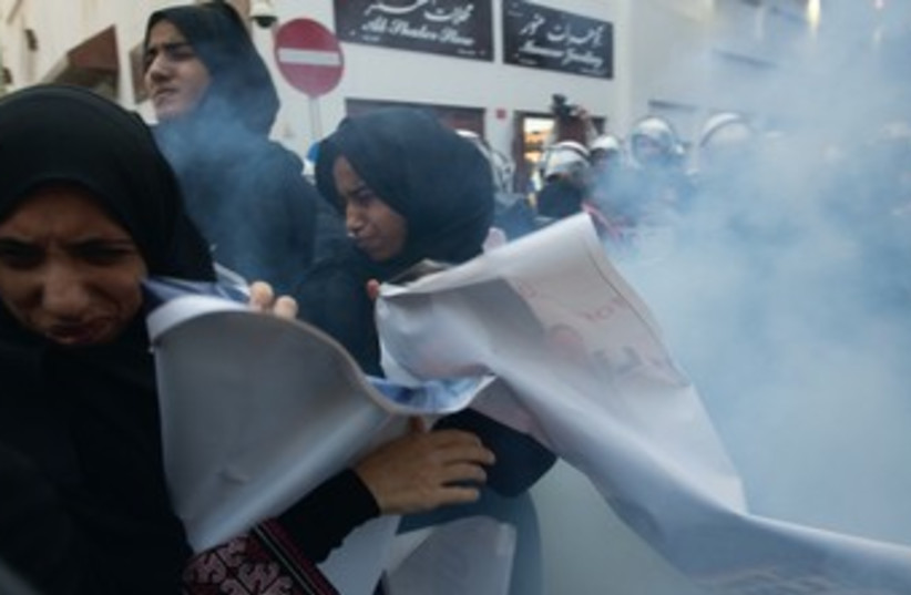 Protesters in Manama react to sound grenade 370 (photo credit: reuters)