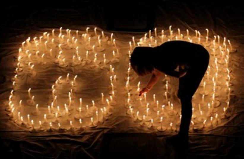 Candles to celebrate Earth Hour 370 (photo credit: REUTERS/Jaime Saldarriaga)