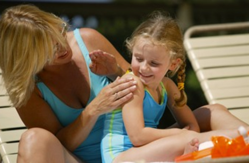 Children in the sun child sunscreen sun block 370 (photo credit: Thinkstock/Imagebank)