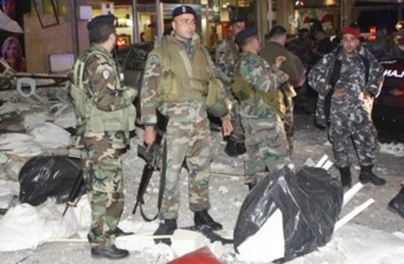 Lebanese soldiers at bombed Tyre restaurant_370 (photo credit: Haidar Hawila/Reuters)