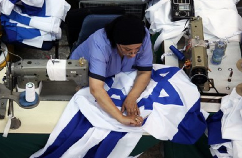 Preparing flags at the Kalman Berman flag factory