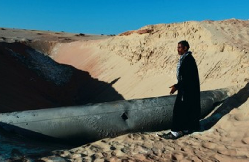 BEDUIN man looks at a gas pipeline in Sinai 370 (photo credit: REUTERS)