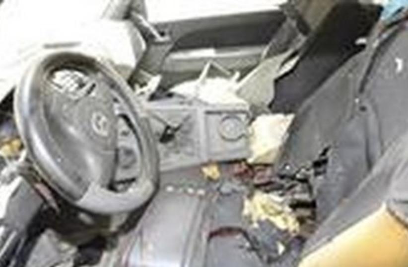Blown up car (photo credit: Reuters/SANA/Handout)