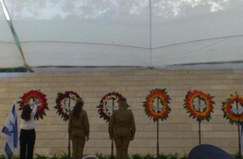 A wreath is laid in honor of IDF widows 370 (photo credit: melanie lidman)