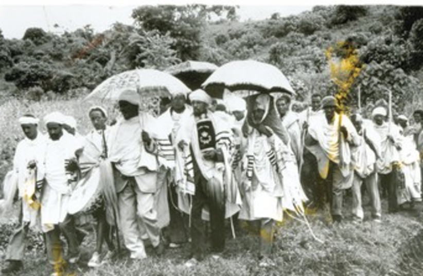 Jews in an Ethiopian village in procession to synagogue (photo credit: Don Robinson)