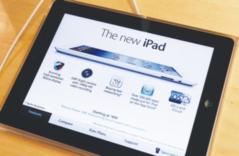 APPLE'S NEWEST iPad 370 (photo credit: Shannon Stapleton/Reuters)