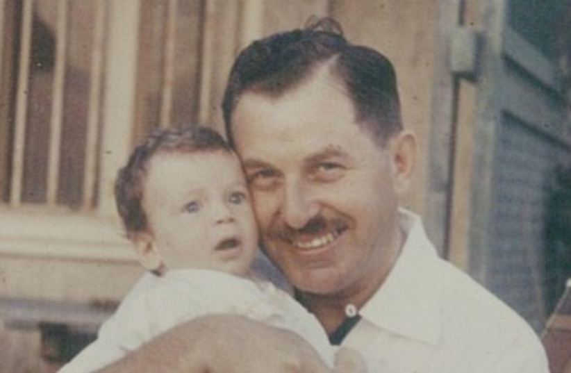 Isaac Herzog as a baby with his father, Chaim Herzog in 1960 (photo credit: Courtesy Herzog family)