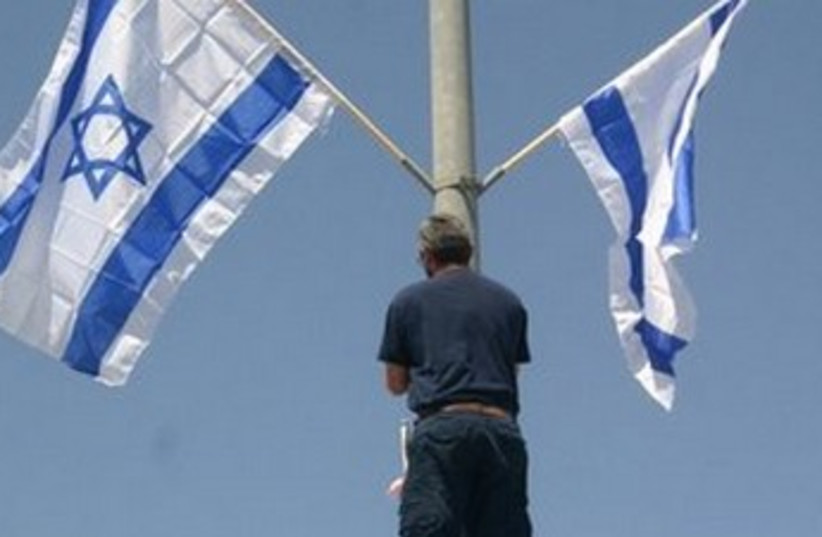 Beit Shemesh resident erects Israeli flag 370 (photo credit: picture credits - Menachem Lipkin)