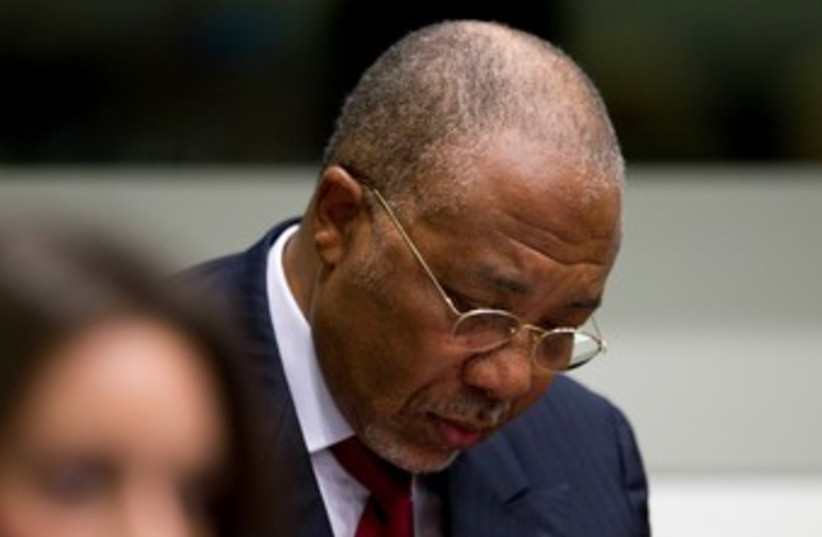 Charles Taylor in the Hague 370 (R) (photo credit: REUTERS/Peter Dejong/Pool)