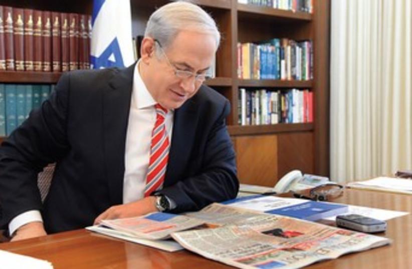 Prime Minister Netanyahu reads Jerusalem Post (photo credit: Illustrative Photo )
