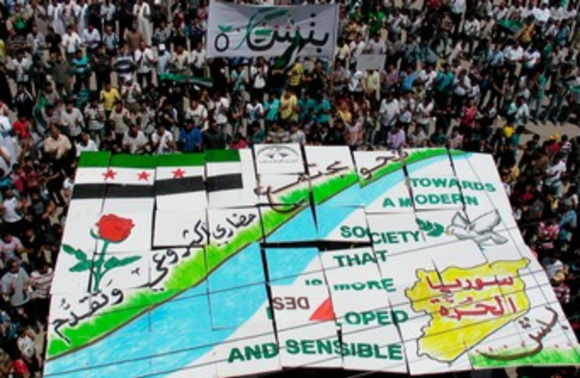 Demonstrators in Idlib against Syrian President Assad 370 (photo credit: REUTER/Shaam News Network/Handout)