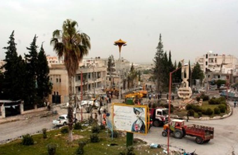 Site of bomb blast in Syria's Idlib 370 (photo credit: REUTERS/SANA/Handout )