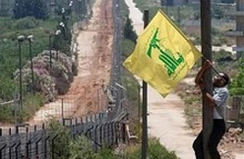Hizbullah flag border 248.88 (photo credit: AP [file])