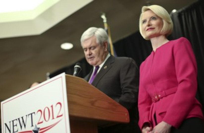 Newt Gingrich and his wife Callista 370 (photo credit: REUTERS)