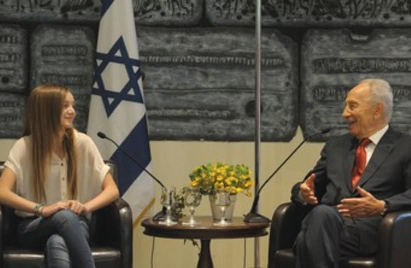 PRESIDENT SHIMON PERES speaks with Noa Weinzweig 370 (photo credit: Mark Neiman/GPO)