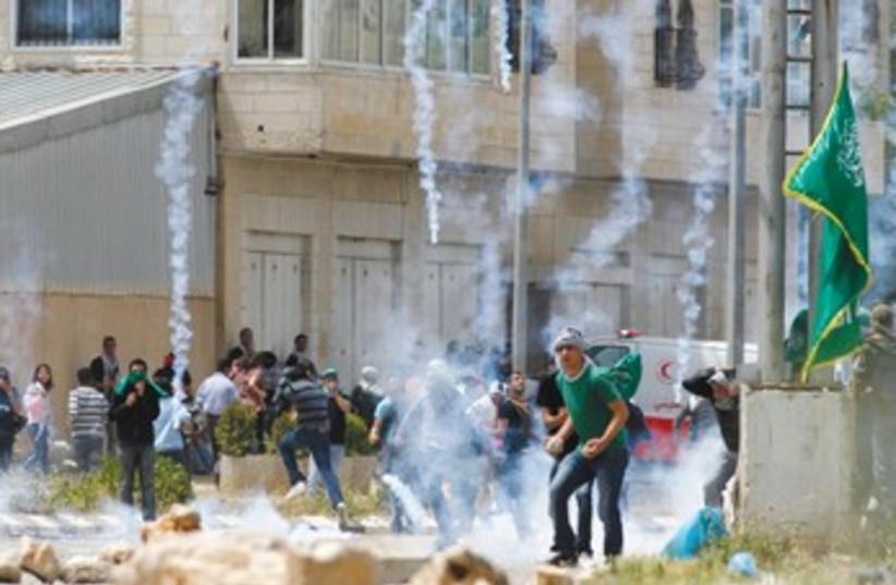 Arabs riot near Ofer Prison 370 (photo credit: Mohamad Torokman/Reuters)