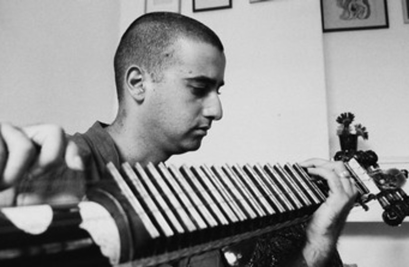 Indian man playing instrument 370 (photo credit: Courtesy)