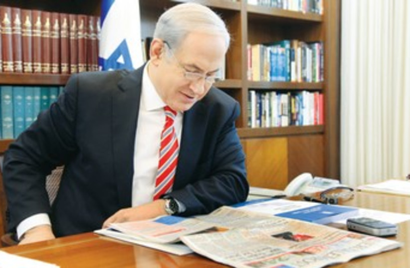 PM Netanyahu reading 'The Jerusalem Post' 370 (photo credit: Marc Israel Sellem)