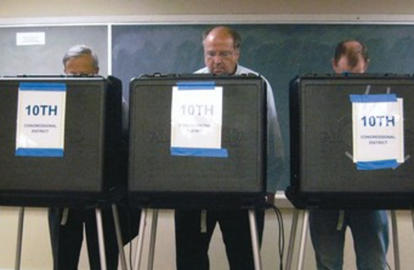 US voters at a polling station in the US 370 (photo credit: Reuters)