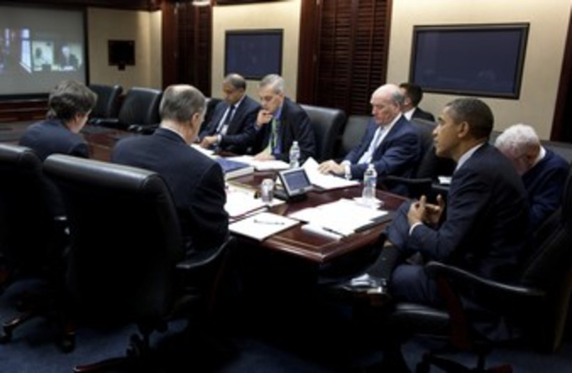 President Obama, Denis Mcdonough and others (photo credit: Reuters/Pete Souza/White House/Handout)